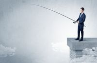 Businessman fishing nothing from the top