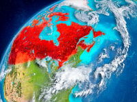 Space view of Canada in red