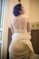 old bath room, brunette woman in antique silk nightdress and hairstyle in the style of the 20s