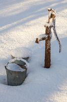 Water pump in the garden at winter
