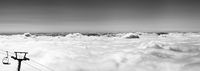 Black and white panorama of mountains under clouds at nice sun day
