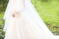 Young pretty bride outdoors