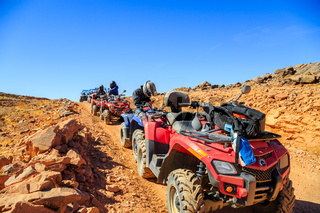 Ait Saoun, Morocco - February 23, 2016: Quad bikes in desert at the sunset