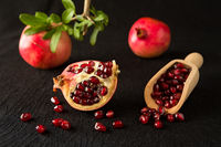 Ripe pomegranate fruits and bailer with seeds inside