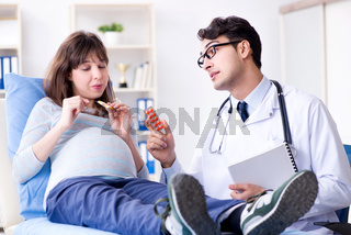 Pregnant woman visiting doctor for consultation
