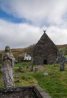 Kilmalkedar church with cloudy sky