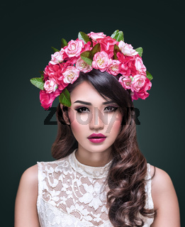 Portrait of beautiful asian woman with flower wreath