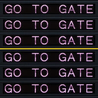 Airport departure board with go to gate sign.