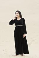 Young brunette standing in desert