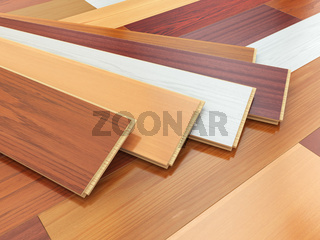 Parquet o laminate wooden planks of the different colors on the floor.