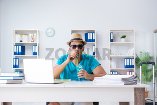 Businessman preparing for vacation in the office