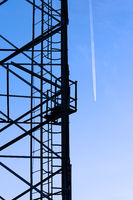 Large tower of metal structures against the blue sky. Metal construction.