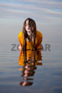 girl posing in the Water at sunset