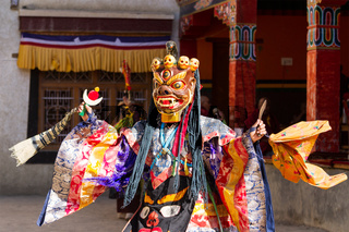 Lamayuru. Monk in mask performs buddhist sacred cham dance