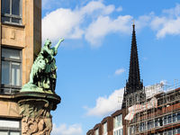 outdoor sculpture and steeple Church in Hamburg