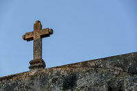 Beautiful Old Cross Against A Blue Sky