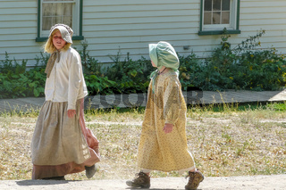 girls dressed in traditional clothes from the american pioneer era Heritage Park