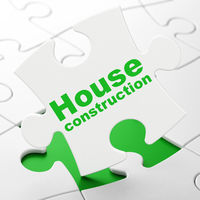 Constructing concept: House Construction on puzzle background