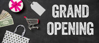 Shopping concept- Grand opening written on a blackboard