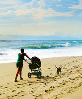 Beach walking with baby carriage