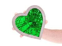Adult holding heart filled with a large green ruby