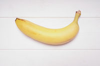 banana on rustic white wooden background
