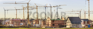 panoramic view to construction site of new build residential houses
