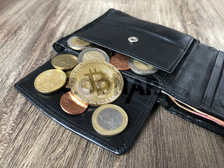 wallet with bitcoin euro and cent coins