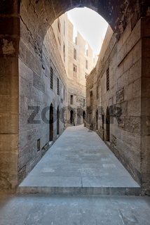 Narrow passage with old grunge stone walls, Cairo, Egypt
