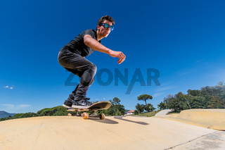 Skateboarder on a pump track park