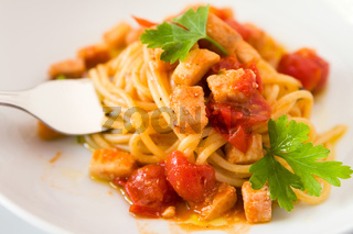 Spaghetti with fish little tomatoes and parsley