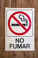 no smokin sign with spanish text