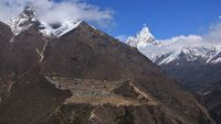 Sherpa village Phortse and snow covered mount Ama Dablam.