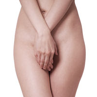 midsection of unrecognizable naked woman covering private parts