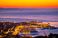 Aerial evening view of Trieste city center and waterfront