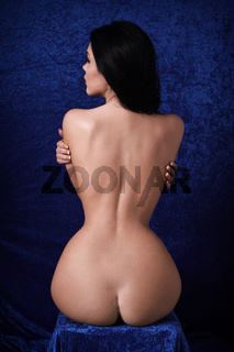 rear view of naked woman with hourglass figure
