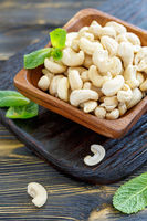 Cashew nuts in a wooden bowl.