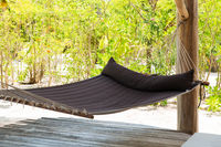 hammock on tropical beach terrace