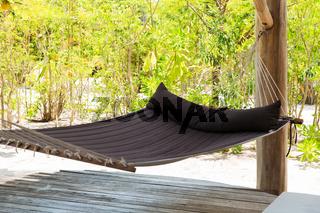 hammock on tropical beach terrace
