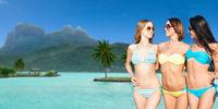 smiling young women in bikini on bora bora beach