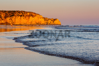 Sunset at Porto de Mos Beach in Lagos, Algarve, Portugal