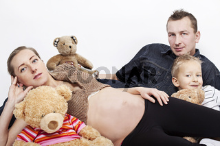 happy family posing with tree teddy bears