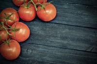Cherry tomatoes on blue dark wooden background