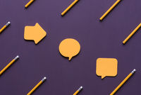 Diverse shaped sticky notes and pencils