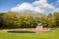 Royal Lazienki Park in spring and Fryderyk Chopin Monument in Warsaw