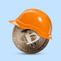 Gold coin bitcoin in a construction helmet on a blue background
