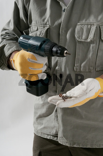Close-up of a man with drill