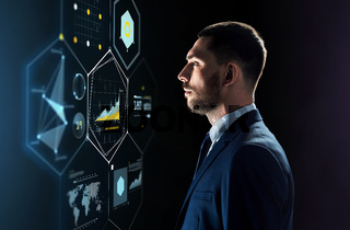 businessman in suit looking at virtual projection