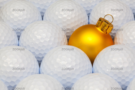 Gold  Christmas decoration between the golf balls