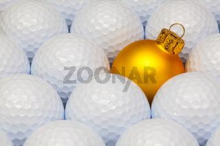 Gold  Christmas decoration between the golf balls